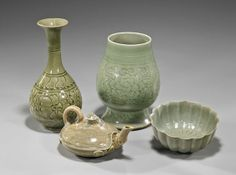 """Group of four Chinese Song and Yuan-style celadons, including: Yaozhou-type bottle vase with carved florals; wide mouthed ovoid form footed vase with carved florals; foliate form bowl; and a turtle-form teapot with cover; H: 7 1/2"""" (largest)"""