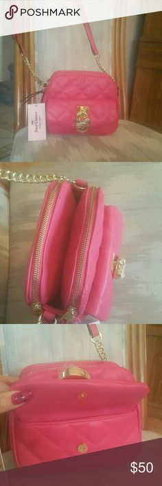 """Juicy couture raspberry color cross body bag Juicy couture raspberry color cross body bag.  Had 2 zipper pouches with open middle pouch. Front has a cute gold heart shape lock that unsnaps with a small pouch. 7 1/2"""" wide, 6 1/4"""" tall, 3"""" deep. Juicy Couture Bags Crossbody Bags"""