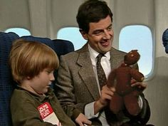 Quick Clip---------On a Plane with Mr Bean---Mr Bean takes a plane. When the stewardess asks him to occupy a child who is sitting next to him he tries hilarious methods to help the little boy feel better