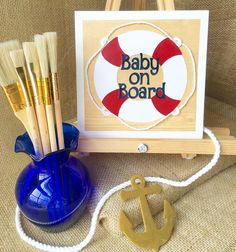Looking for a baby shower gift? Why not give a one-of-a-kind handmade piece of art for the nursery! You can find this piece and other nautical themed nursery pieces at my Etsy shop! #goldenanchorart #nursery #nurseryart #nurserydecor #babyonboard #baby #nautical #nauticalnursery #nauticalbabyshower #babyshower #Etsy #shop #gift #babyshowergift