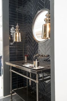 The black tiles and metal accents make this industrial powder room look chic Bad Inspiration, Bathroom Inspiration, Chevron Tile, Herringbone Tile, Black Chevron, Black Tiles, Black Marble Tile, Small Bathroom, Mirror Bathroom