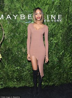 Working it: Supermodel Jourdan Dunn looked incredible in a brown jersey dress at the Maybelline NYFW party held at the Rivington Rooftop on Monday night