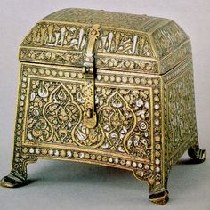 image courtesy of 'Treasures of Islam' exhibition catalogue, Geneva, 1985. cat. 272 brass, inlaid with silver casket. dimensions: 13x13.5 western Iran, 14th century potentially has similar sort of 'working out' to my casket on front attachment.