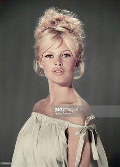 Studio portrait of actor and model Brigitte Bardot wearing a light blue…
