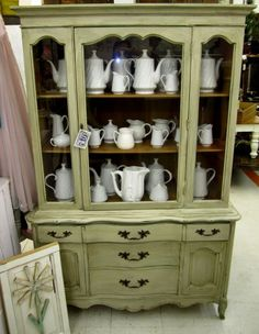 Doing something similar to this to my china cabinet!! I'm going to wallpaper the inside though....hope it turns out ;)