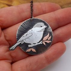 A sweet chickadee pendant. Handcrafted in eco friendly mixed metals.