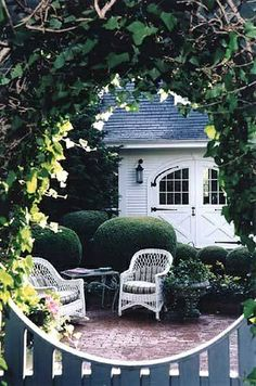 Fabulous garage doors and garden setting. I want to create this sort of look in my back yard!!!