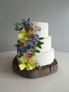 Beautiful sugar wild flowers give the finishing flourish on this rustic textured wedding cake. Wedding Cake Maker, 3 Tier Wedding Cakes, Luxury Wedding Cake, Floral Wedding Cakes, Amazing Wedding Cakes, White Wedding Cakes, Elegant Wedding Cakes, Wedding Cakes With Flowers, Elegant Cakes