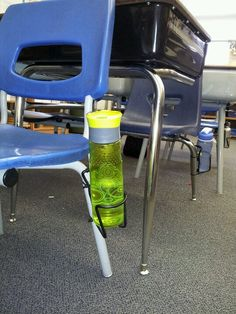 What a good idea for dealing with those pesky water bottles!  Use a bicycle water bottle rack on chair legs!