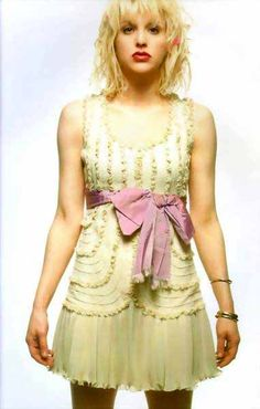 "I never was a big fan of the band, ""Hole,"" or Courtney Love herself, but I'd be lying if I didn't admit to loving Courtney's style circa 1990's.  She always wore amazing vintage dresses and this is one of many I remember pining after..I'd wear it with a black cardigan of course ;)"