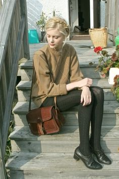 camel sweater, black knit tights and oxfords, brown satchel.