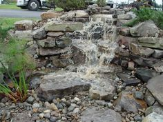 Large Outdoor Stone Themed Pondless Waterfalls Design