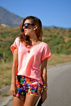 coral top and colourful shorts