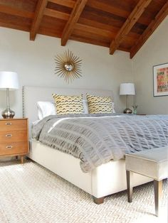 "In a space dominated by bold architectural elements, it can make sense to limit the rest of the design features to a selection of richly textured neutrals. ""Here we combined soft taupe-gray paint with a muted palette to create a soothing master bedroom retreat,"" says designer Jennifer Johnson. ""Various tones of gray and a mix of textures add just enough interest without feeling too busy."""