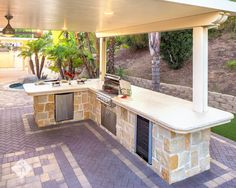 A backyard remodel should encompass elements that make your outdoor space the ideal retreat or oasis if you will. Elements featured in this project that were designed and installed by System Pavers include: a custom gas fire pit with oversized paver bench seating, paver patio and courtyard, double pergolas, an oversized bar top with attached built-in bbq, wine refrigerator, outdoor electrical hookups, and over 500 square feet of artificial tu
