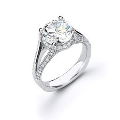 Diamond Engagement Ring MR1457 - Diamond Engagement Ring MR1457 General Information: Metal: 14k White GoldCut: Round Diamonds Pave Set on the band.Carat Weight: 0.55 tdw Center Stone Information: Cut: Round BrilliantCarat Weight: 1.00 crtColor: GClarity: SI1