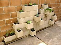 Your backyard's new best friend may be the humble, lowly cinder block. What it lacks in pizzazz it makes up for in versatility, durability and affordability. Each one costs a little more than a buck and, with some imagination, can be used in countless ways to add function and flair to your outdoor space. Here are ten DIY cinderblock ideas to steal, modify and make your own: