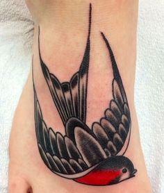 Traditional swallow tattoo      by Melanie at Lark Tattoo, Albany, NY
