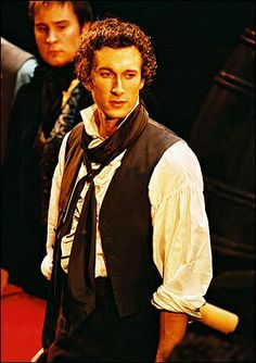 Aaron Lazar (looking at either Marius or Grantaire, depending on the ABC Cafe lyric at this moment). I love the old pre-barricade costuming for Enjolras.