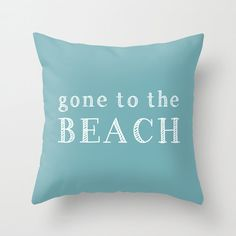 Gone to the Beach Pillow in White on your choice of color (colors shown are Marine Blue, Sand, Coral and Navy). A fresh accent in your beach decor