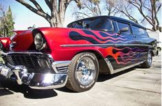 Call Ken 408-209-7794 $25,000. Trophy Winning Show Car - Custom Paint 1956 Chevy 210 Wagon  Custom interior and paint. Black with flames, black tuck and roll interior  Must see it in person to appreciate the full beauty of this classic.  1956 Chevrolet Station Wagon 2 door 210 Handyman Chopped top Custom interior Custom paint & flames Cragar Rims 350-4 bolt main Twin Edelbrock 500 carburetors Edelbrock intake manifold Chrome fan and water pump Chrome single wire alterna