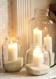 Sand and candles in mason jars. This would look much better with a light soft pink sand.  Jen