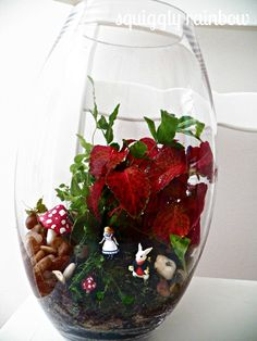This open oval shaped miniature garden stands approximately 30cm tall. Plants will vary depending on seasonal availability. You can also choose from a selection of miniatures to tell a story in your garden. Send me a message to discuss your designs... we have anything from Alice to a wood-chopper to a billy-cart race. Terrarium 'stories' have endless possibilities!
