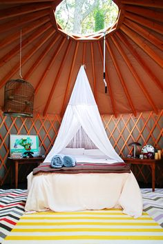 """Nothing says """"Glamping"""" like an beautiful yurt with trendy graphic prints! and a bird cage. Yurt Living, Outdoor Living, Living Spaces, Living Room, Hamptons House, The Hamptons, Glamping, Yurt Camping, Bedroom Decor"""