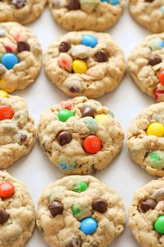 Peanut butter oatmeal cookies packed with m&m's and chocolate chips. These monster cookies are incredibly soft, chewy, thick, and so easy to make! Chocolate Chip M&m Cookies, Chewy Peanut Butter Cookies, Chocolate Chip Oatmeal, Chocolate Chips, Raisin Cookies, M&m Cookie Recipe, Cookie Recipes, Dessert Recipes, Delicious Desserts