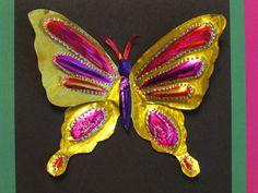 "3rd grade embossed butterfly tin art; 7"" wide; lesson by art teacher: Susan Joe"