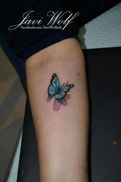 Javi Wolf Tattoo- 3d butterfly on arm, blue