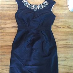 Elegant Jeweled Collar Dress Elegant Jeweled Collar Dress. Size 6. Is a sateen black dress with pink satin interior. Zippers down the back. Has beautiful bold jewels around the collar. Cap sleeve.  In excellent condition. No signs of rips stains or flaws. London Times Dresses