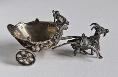 A wonderful antique Continental Silver Goat draw Chariot with revolving wheels.  Small child or cupid with whip, at the helm of the gilted interior of