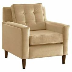 """Midcentury-inspired arm chair with a tufted back cushion and exposed legs. Handmade in the USA.  Product: ChairConstruction Material: Polyester and woodColor: Velvet buckwheatFeatures: Handmade in the USADimensions: 35"""" H x 31.5"""" W x 32"""" DNote: Assembly requiredCleaning and Care: Spot clean"""