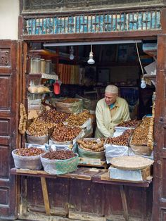 A date seller and his shop in the Medina in Fes, Morocco