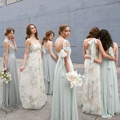 Strapless, One-Shoulder, Halter, Double Cap Sleeve...the options are endless with the convertible Nabi Collection! Mira Dress in Spring Mint + Morning Mist and Nyla in Ivory/Sage Vintage Floral Chiffon  photo by @thismodernromance | hair + makeup by @kcwitkamp | florals by @runningwildflorals  #jycmira #jycnyla #nabibyjennyyoo #springmint #morningmist #jycfloralprint #convertibledress #onedressendlesspossibilities