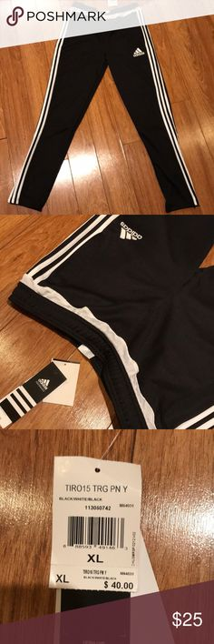 Adidas sweatpants Brand new with tags adidas youth sweatpants. Featuring white stripes on sides, zip bottoms and adidas logo on top leg. Two sizes are available XL and medium. Offers are welcomed adidas Bottoms Sweatpants & Joggers