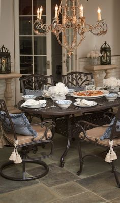 Pull up to a dining table inspired by the glorious French architecture of New Orleans.    Frontgate: Live Beautifully Outdoors