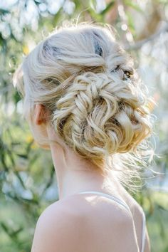 Romantic braided bun wedding hair | Camilla Kirk Photography