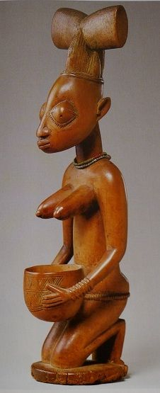 Sango shrine figure with bowl Yoruba, Nigeria, early 20th century wood, h. 52 cm