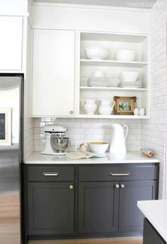 Dark grey lower cabinets, white uppers.
