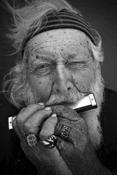 harmonica player- doesn't he look awesome,  I can almost hear what he's playing ! def. playin that funky music......