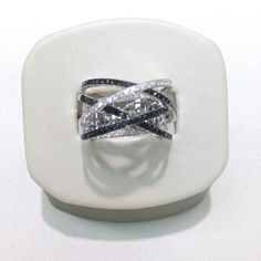 White gold criss-cross ring w/ black diamonds