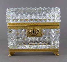 Gorgeous antique French cut crystal jewelry casket or box circled by ornate gilt bronze mounts. The crystal is cut in an all over diamond point pattern accented by a 16-point starburst at the bottom. www.theantiqueboutique.rubylane.com