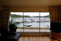 minimal windows sliding doors offers slim framing of maximising the views of the harbour. Timber Sliding Doors, Sliding Door Panels, Aluminium Sliding Doors, Sliding Glass Door, Glass Doors, Glass Structure, Timber Cladding, Glass Design, Modern House Design