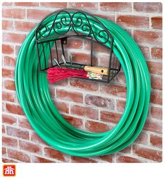 A stylish way to hang your garden hose and store the accessories without losing floor space.