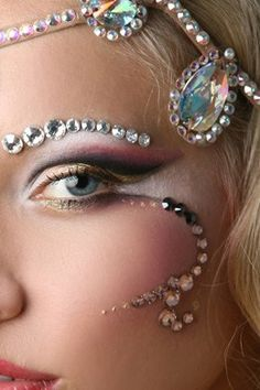 LOVE! Simple but Dramatic eye make-up adorned with jewels of varying sizes.