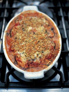 Eggplant/Aubergine Parmesan. Melanzana Parmiggiano. This classic southern Italian recipe layers aubergine with parmesan and tomatoes. Great served with all sorts of roasted meats and with roasted fish as well.