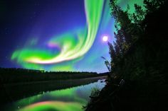 Northern Lights reflected in the Yukon River 35 km. east of Whitehorse, Yukon, Alaska on the night of Sept. 3, 2012