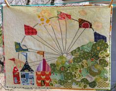 """Ferris Wheel Quilt by Dana at Old Red Barn Co: """"On my street, on someones private property, is a Ferris wheel. for all this time an idea of a Ferris wheel ticker tape quilt has been percolating in my brain. Will the ferris wheel be her theme? House Quilts, Barn Quilts, Granny Square Quilt, Fabric Postcards, Quilting Designs, Quilting Ideas, Small Quilts, Free Motion Quilting, Applique Quilts"""